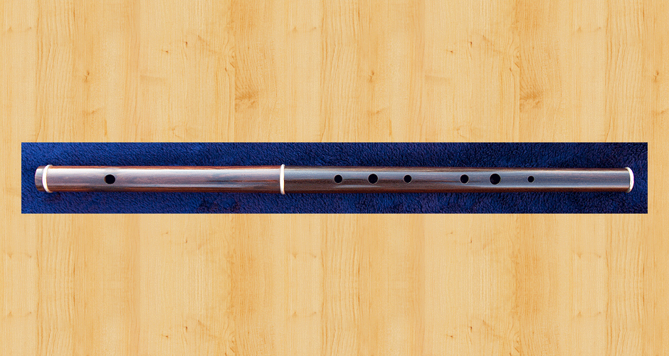 A Martin Doyle Traditional D flute made from cocus wood with three sterling silver ferrules. (Unfortunately cocus wood is no longer available.)