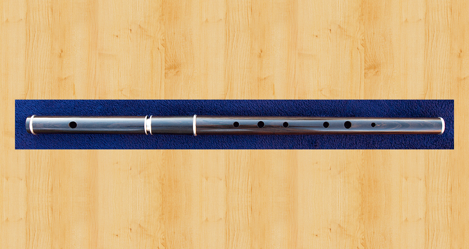 A Martin Doyle Traditional D flute made from African blackwood. This flute is fitted with a sterling silver thin-walled tuning slide and three sterling silver ferrules.