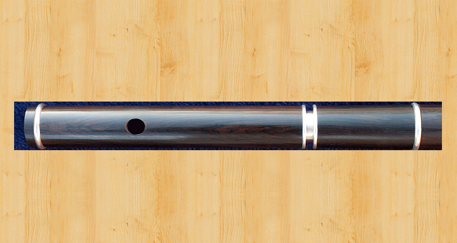 A close-up of the headjoint and tuning slide from the previous flute.