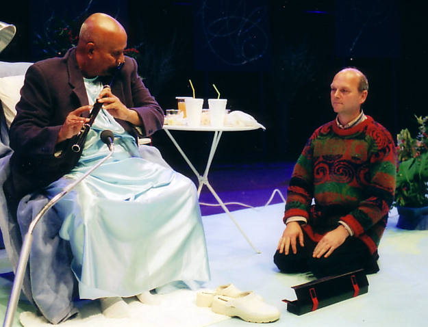Martin Doyle watches as Sri Chinmoy tries the new flute.