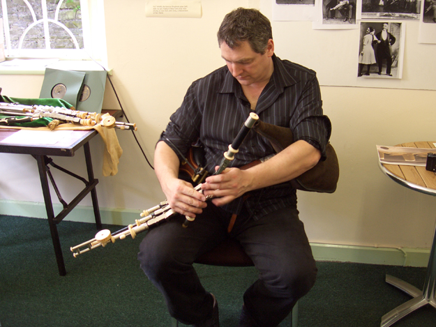Ronan Browne playing another set of pipes at the Traditional Day in Millmount.