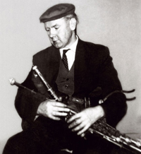 Willie Clancy playing the pipes.